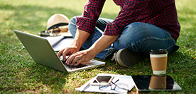 image of student on laptop outdoors